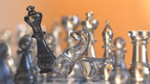 chess figures battle scene represents business strategy